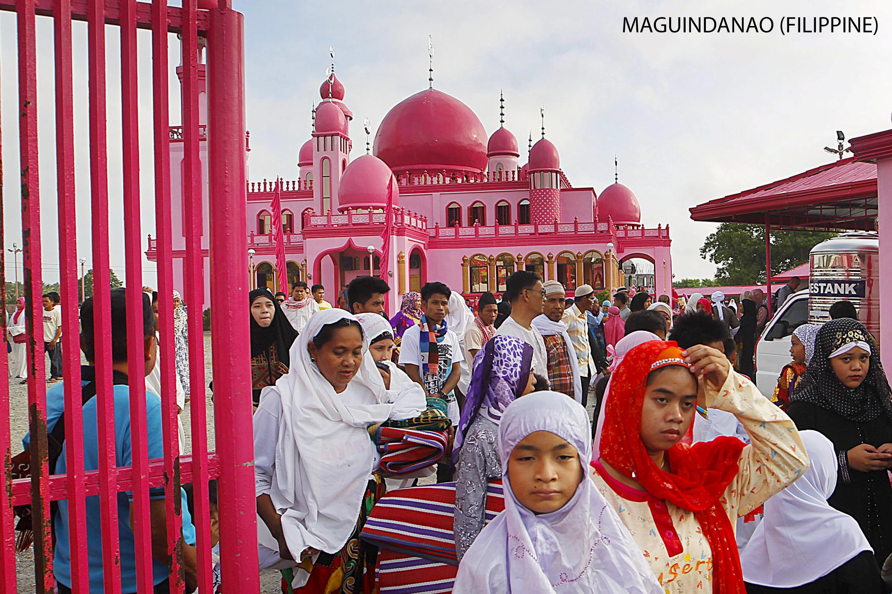 Filipino Muslims leave after attending the morning prayers of Eid al-Fitr holiday, marking the end of the holy month of Ramadan, at the Pink Mosque in Datu Saudi Ampatuan town, Maguindanao province in southern Philippines July 17, 2015. REUTERS/Marconi Navales