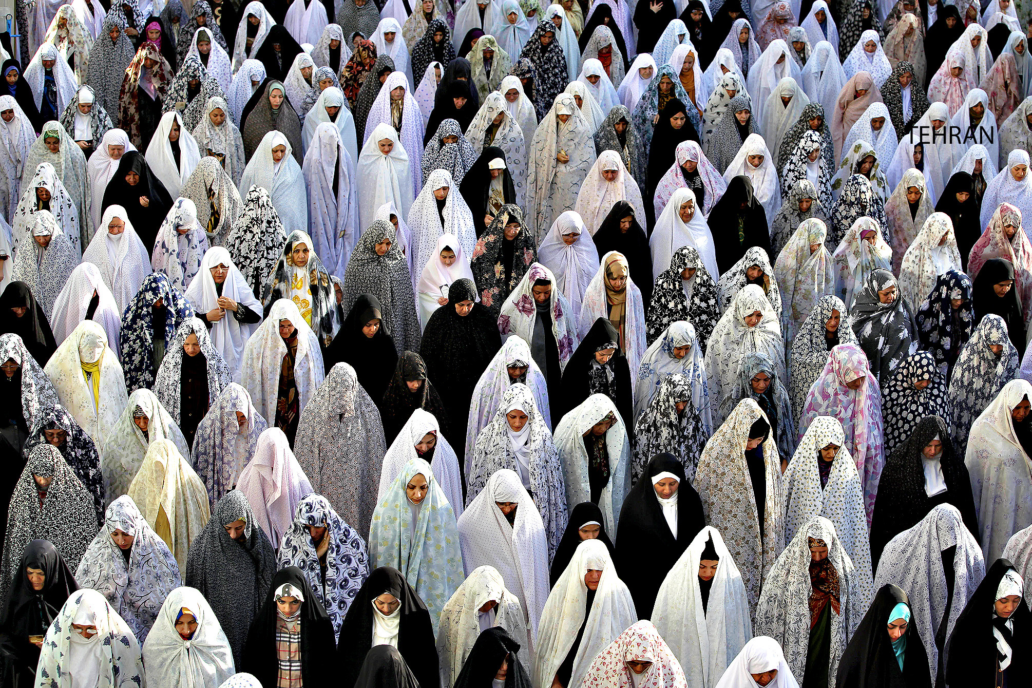 Iranian women pray during the Eid al-Fitr prayer in Tehran, Iran, Friday, Aug. 9, 2013. The Eid al-Fitr celebration marks the end of the holy month of Ramadan, during which Muslims all over the world fast from sunrise to sunset. (AP Photo/Ebrahim Noroozi)