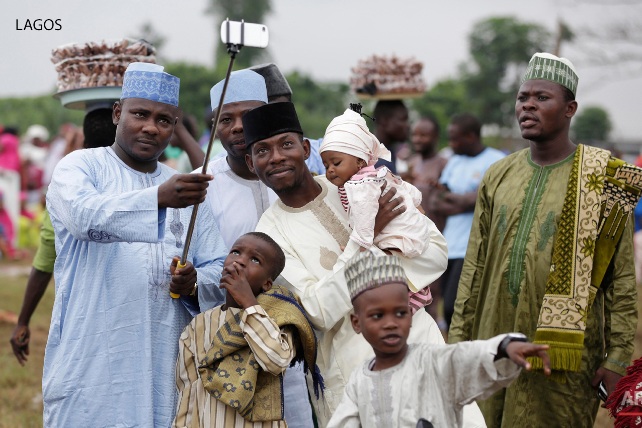 A Nigeria Muslim family takes a selfie portrait before Eid al-Fitr prayer, marking the end of the Muslim holy fasting month of Ramadan in Lagos, Nigeria, Friday, July 17, 2015. (AP Photo/Sunday Alamba)